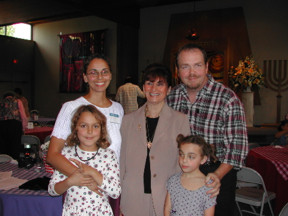 Judy and my family. (Judy is in the centre. We took this picture.)