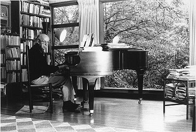 Copland composing at his piano (Absolute Astronomy http://www.absoluteastronomy.com)