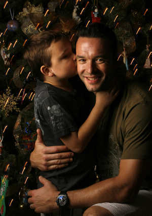 Olaf Kolzig with his son, Carson. (Photo by Dirk Shadd, St. Petersburg Times)