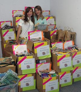 Chelsey Barrios, left, Kirsten Jerzyk, and their classmates collected 4,179 books for Read to Grow