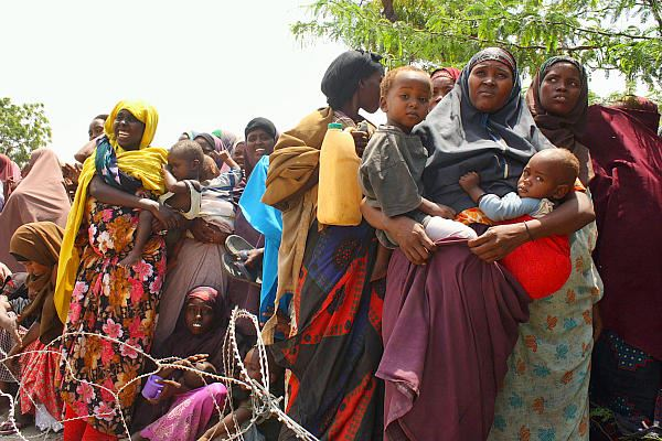 Somalis await aid at a camp in the Howlwadag district of Mogadishu on Aug. 25, 2011. Drought in the