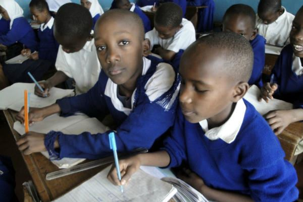 Students squeeze together in crowded desks at Majengo Primary School in Moshi, Tanzania. Like many p