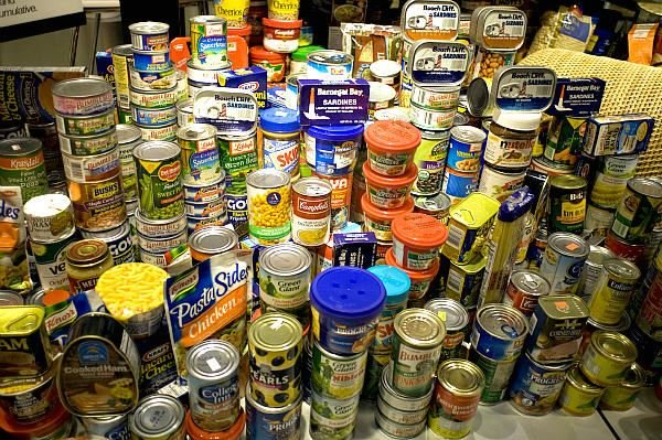 Cans stacked up at a food drive in New York City. Operation Just One Can has a simple theme: Donate