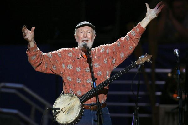 Pete Seeger performing with a banjo