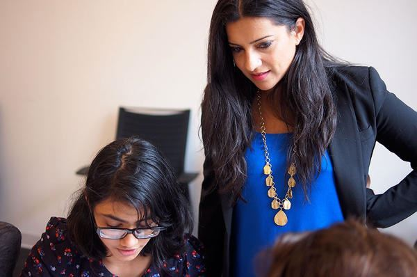 Reshma Saujani (r.) and a Girls Who Code participant visit AppNexus, an online advertising company based in New York City.