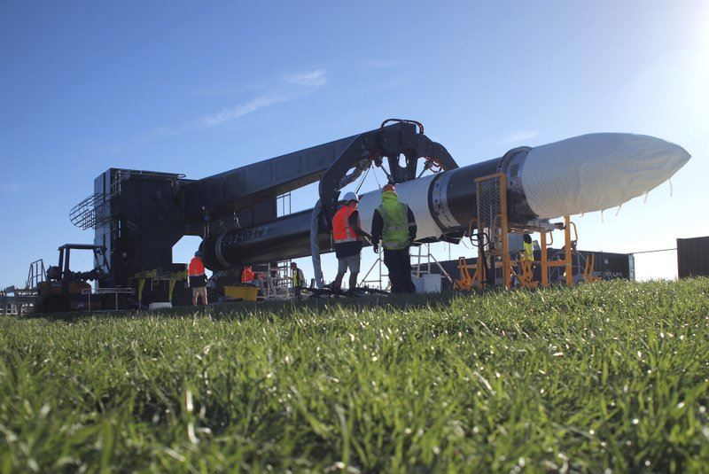Engineers work with the Electron rocket at the launch site on the Mahia Peninsula in the North Island of New Zealand