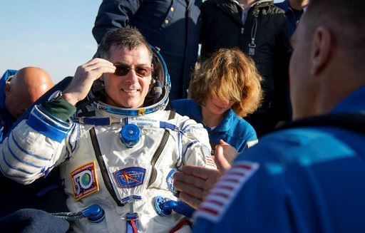 NASA astronaut Shane Kimbrough rests in a chair outside