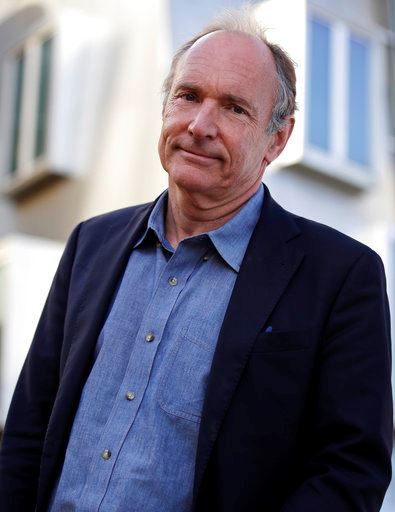 Tim Berners-Lee poses outside his office at the Massachusetts Institute of Technology in Cambridge