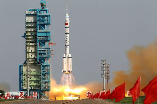 In this June 16, 2012, file photo, the Shenzhou 9 spacecraft rocket launches from the Jiuquan Satellite Launch Center in Jiuquan, China.
