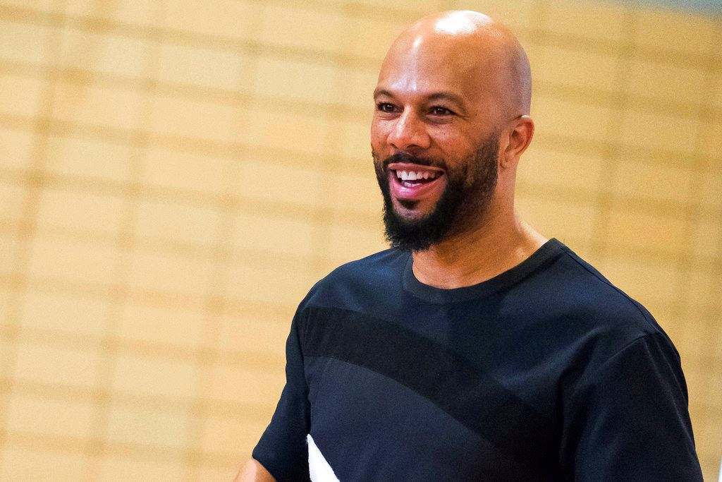 Picture of Rapper Common surprises students at NY school, donates money