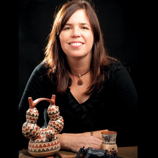 Christina Conlee posing by some artifacts. (https://www.archaeological.org/lecturer/christinaconlee)