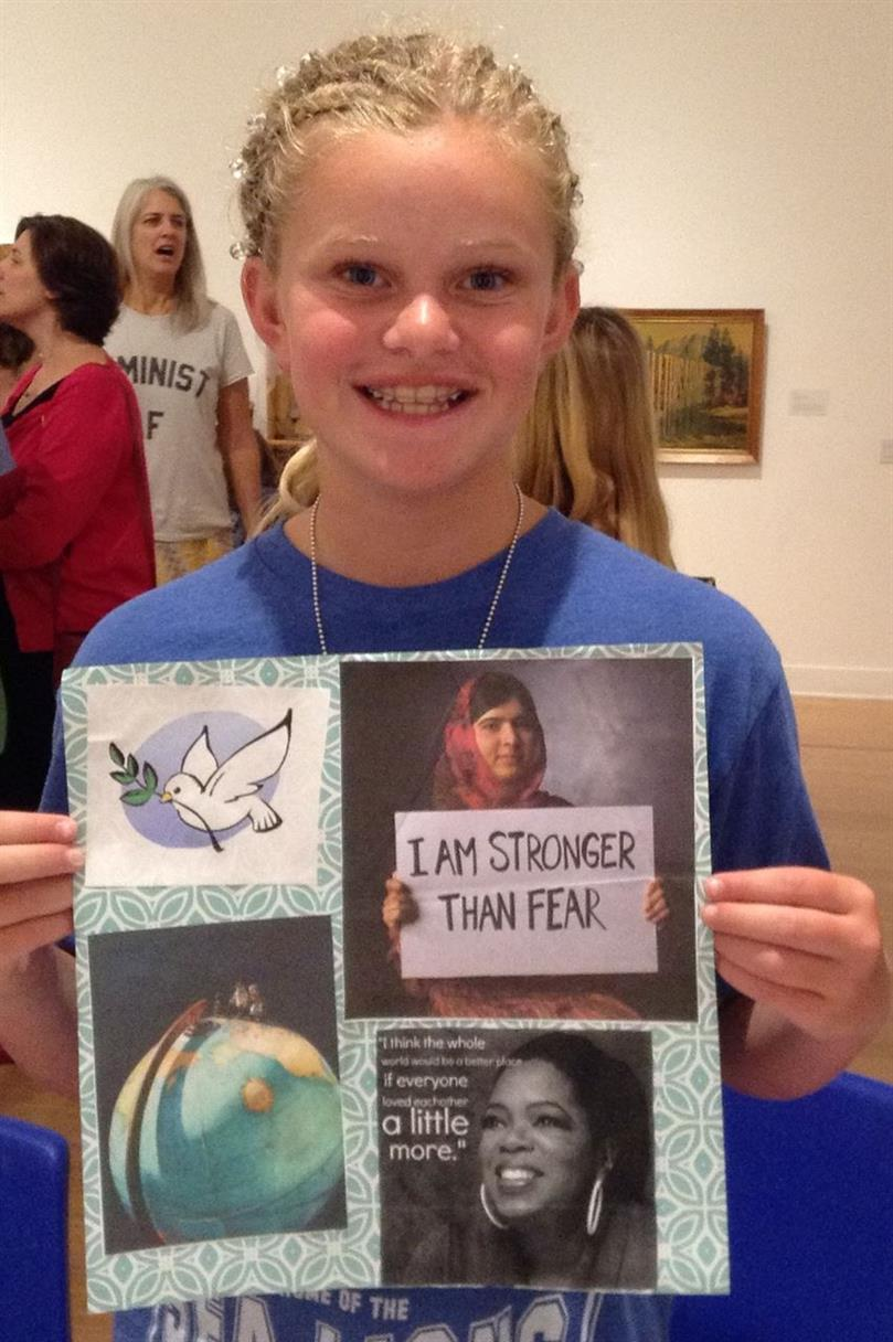 Picture of Young hero artist displays Peace art