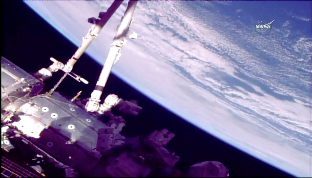 Picture of Spacewalking astronauts finish months of robot arm repair