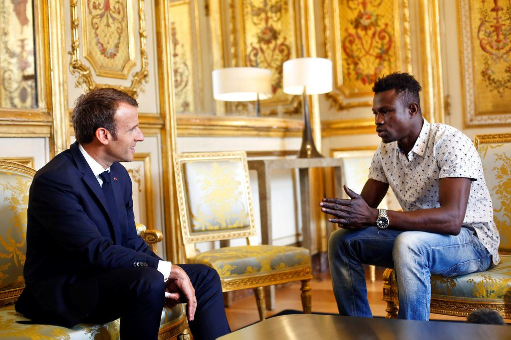 Picture of France: Macron rewards migrant hero who saved dangling child