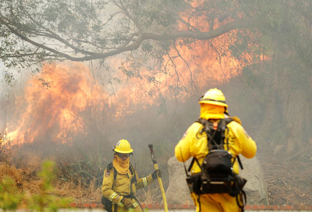 Picture of Crews fight to keep flames from homes in California