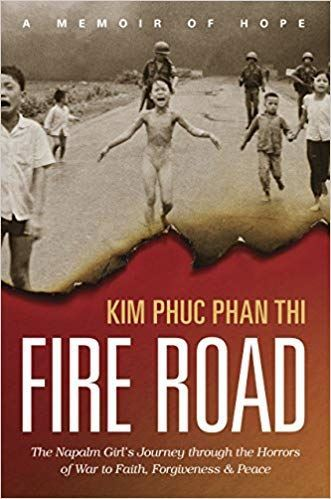 Book cover for the book Fire Road by Kim Phuc. Features famous photo of children running from napalm attack during Vietnam War.