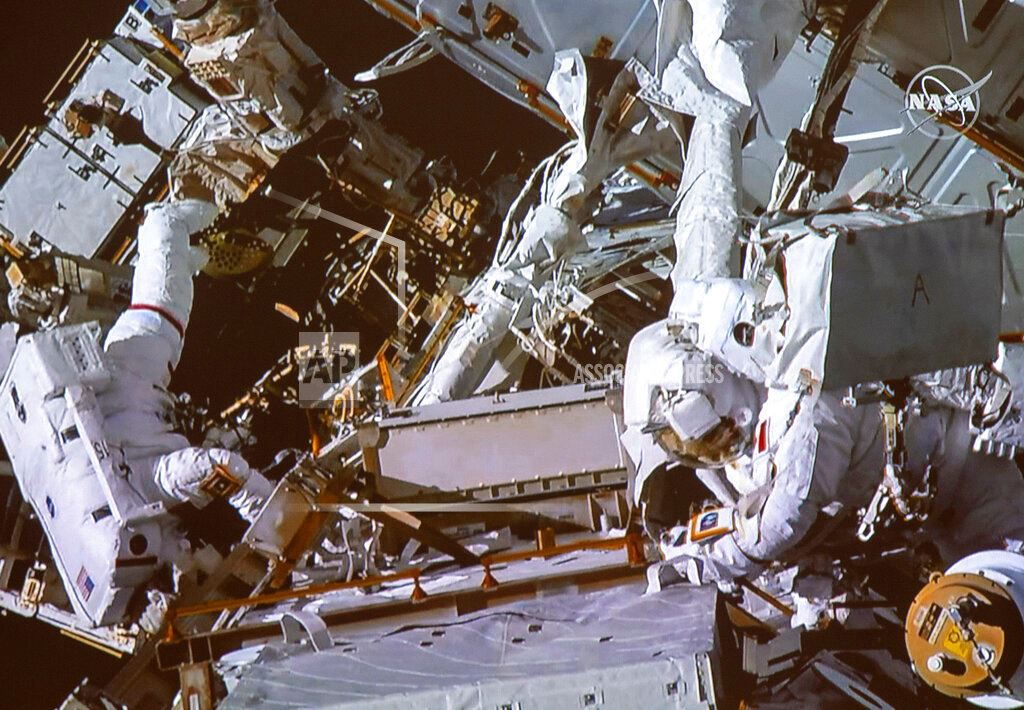Picture of Spacewalking astronauts tackle battery, cable work