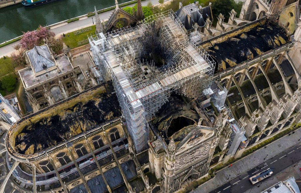 Picture of The Latest: Fire chaplain hailed as hero in Notre Dame blaze