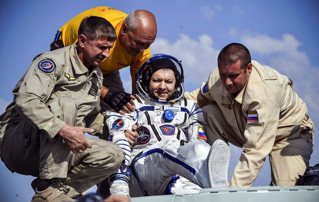 Picture of Canadian, Russian, American back on Earth from space station