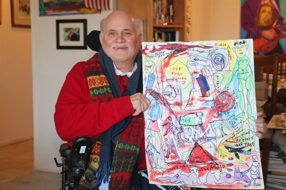 Picture of Artist Ron Kovic with one of his recent drawings