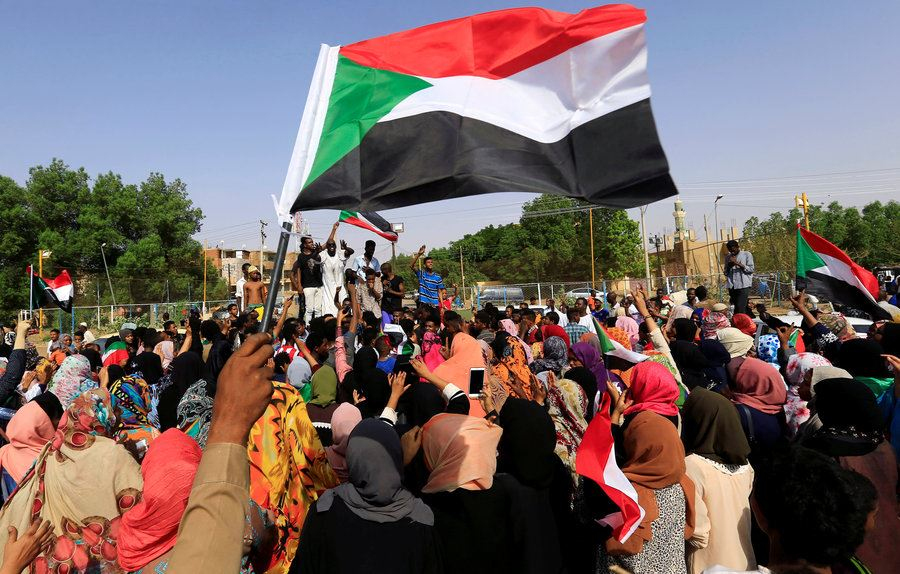 Picture of Sudanese protesters, military celebrate pact after months of unrest