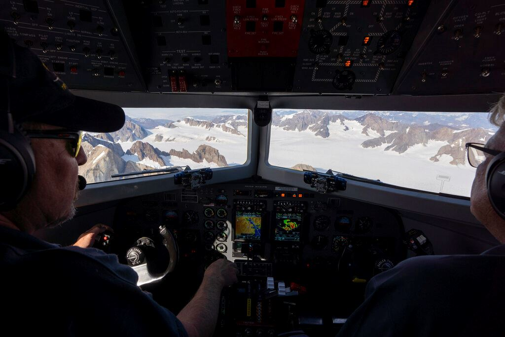 Picture of NASA scientists fly over Greenland to track melting ice
