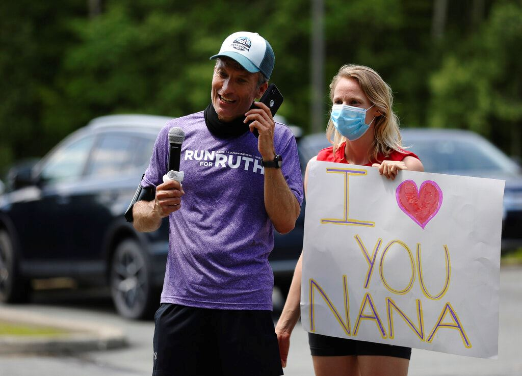 Picture of Man runs 218 miles to virus-stricken 'Nana's' nursing home