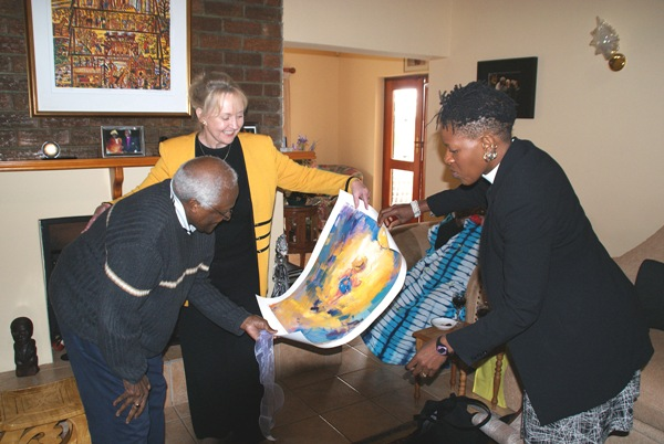 Ann presents a Marilyn Sunderman's limited edition lithograph, <i>Towards Light</i>, to Archbishop Desmond Tutu and  Reverend Mpho Tutu