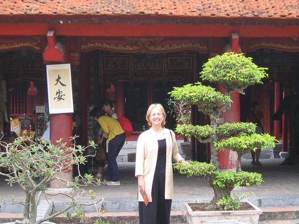 In front of the Temple of Learning in Hanoi, Vietnam, where Ann was working with AIDS orphans.