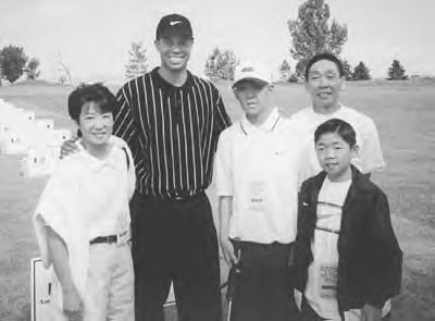 Brandon and his family with Tiger Woods