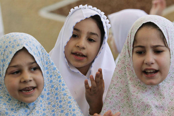 Palestinian girls take part in a re-enactment of the annual Haj pilgrimage to Mecca, at their school in the West Bank city of Nablus, October 10. <P> (Abed Omar Qusini/Reuters)