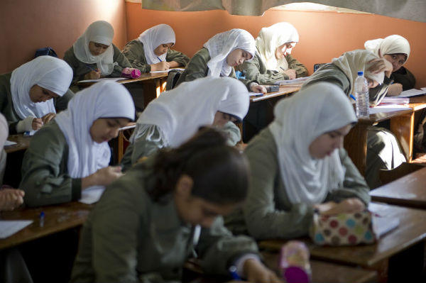 Primary and secondary school girls take a school wide English language test at Al-Redwan Islamic School on November 8, 2012 in the Nasr City district of Cairo, Egypt. <P>(Ann Hermes/The Christian Science Monitor)
