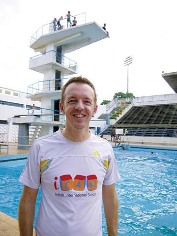 David Hunt at the pool in Phnom Penh, where he coaches a Cambodian children's swim team. <P> Julie Masis