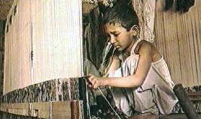 <a href=http://www.mythinglinks.org/ChildLabor~CarpetIndustry~nepalWeaving.jpg>A child weaving</a>