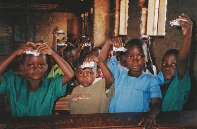Ugandan children learned about the ambulance with miniature Matchbox ambulances.<br>Photo from www.scoutbanana.catholicweb.com
