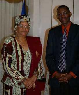 With Liberian President Sirleaf.