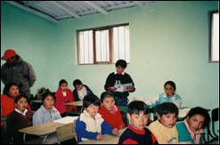Children attending class at their new school in a village in Ecuador<br>Photo from www.freethechildren.org