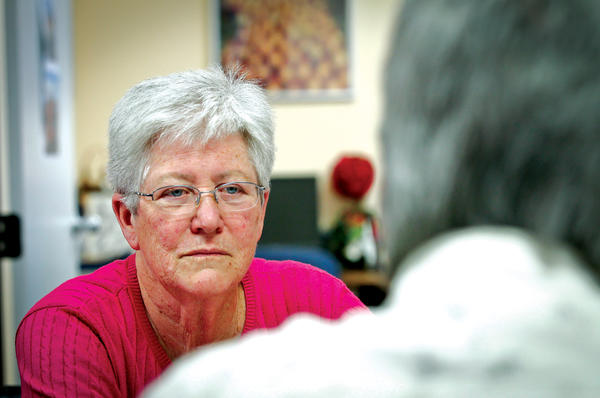 Sister Mary Sean Hodges talks with a former inmate that volunteers at the Office of Restorative Justice for the Archdiocese of Los Angeles.  <P>Tony Avelar/The Christian Science Monitor