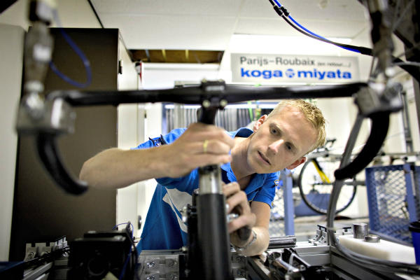 A technician examines a broken Koga Miyata bicycle in the Dutch town of Heerenveen. A 'repair cafe' movement, in which people gather together to fix (and learn how to fix) everyday items from bicycles to lamps, is spreading from The Netherlands to the US and elsewhere. <P> Jerry Lampen/Reuters/File