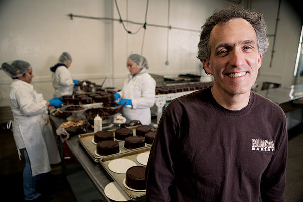 Andrew Stoloff stands in the kitchen of Rubicon Bakery where he employs released prisoners and economically disadvantaged workers.  <P>Melanie Stetson Freeman/Staff