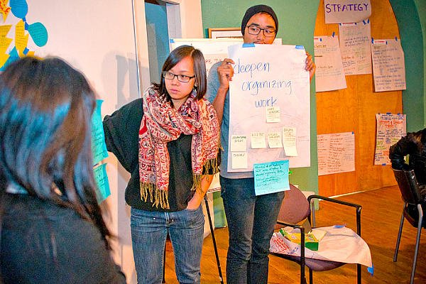 Members of VietUnity in Oakland, Calif., hold a planning session. The group brings Vietnamese-identified people together to work on issues that members have identified as most important to their daily lives, including affordable housing, education, employment, and gang and domestic violence.  <P>Courtesty of VietUnity
