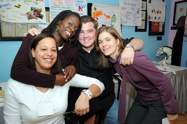 LIz Squibb (far left) helps children who grow up in foster care prepare for life on their own. 'Finding employment is hard enough at this time for young people, let alone children from foster care,' she says.  <P>Courtesy of the Jim Casey Youth Opportunities Initiative
