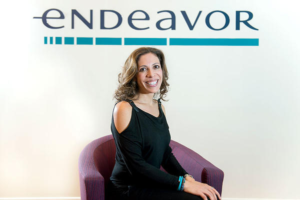 Endeavor Global, cofounded by Linda Rottenberg (here at the nonprofit's headquarters in New York), helps entrepreneurs in emerging markets.  <P>Ann Hermes/Staff