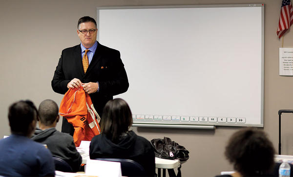 Sam Bracken, with his orange duffel bag, addresses teenagers in an Orange Duffel Bag Initiative class in Atlanta.  <P>Courtesy of Sam Bracken/Orange Duffel Bag Initiative