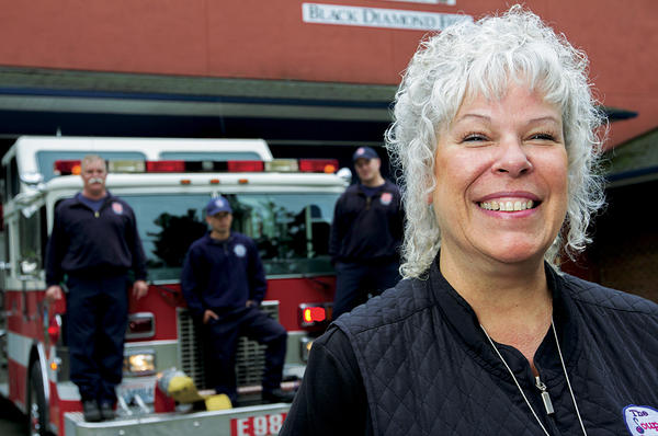 Ginger Passarelli, Soup Ladies president and volunteer, stands in front of the Black Diamond Fire Station 98 in Black Diamond, Wash.  <P>Melanie Conner/Special to The Christian Science Monitor