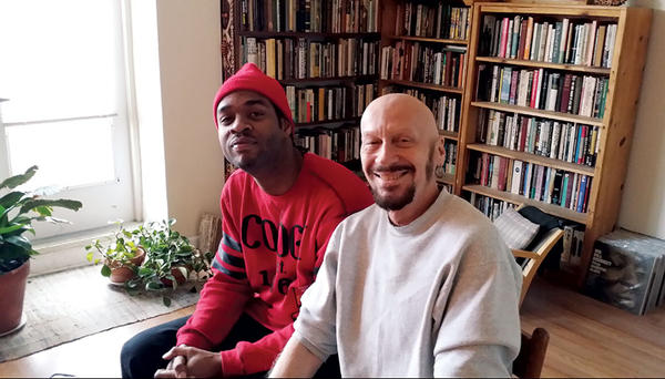 Jovan Hansman (l.) and his adoptive father, Bob Hansman, enjoy time together at Bob's apartment in downtown St. Louis. As Bob's City Faces children's arts program celebrates its 20th anniversary, it also has a new director: Jovan Hansman.  <P>Marjorie Kehe/The Christian Science Monitor