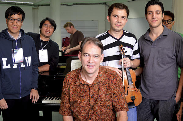 John Ferguson (c.) poses with a class at the YES Academy in Bangkok, Thailand, during a week-long workshop in American musical genres.  <P>Tibor Krausz