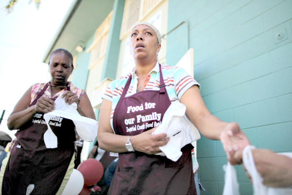 Volunteers hand out groceries at the opening of a food bank to serve the 1,454 residents at the Imperial Courts public housing project in Los Angeles in 2011.  Lucy Nicholson/Reuters/File