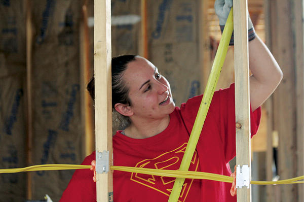 Brittany Aydelotte works on a house in New Orleans. She first traveled to the city as a student at The College of New Jersey in Ewing shortly after hurricane Katrina hit. She has since returned on her own 10 times, leading student service trips.  <P>David Karas
