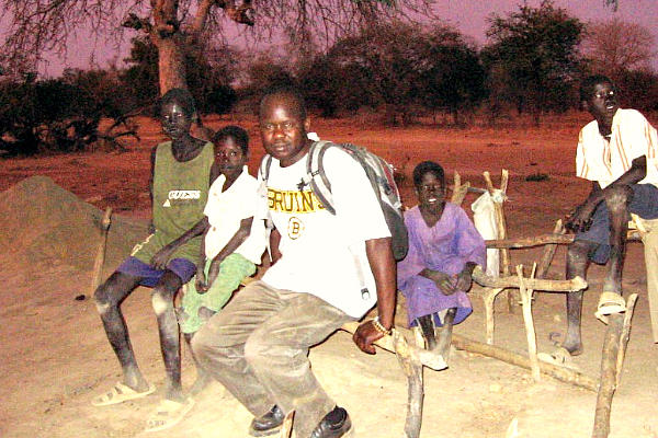 Franco Majok (center, in Bruins shirt) fled from war-torn Sudan and found his way to the US. But after a return visit in 2005 he was moved to create Village Help for South Sudan, which has built a school and other projects in two villages there.  <P>Courtesy of Ron Moulton